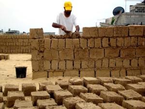 Rebuilding with mud in Gaza