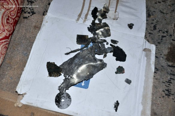 Pieces of the Israeli precision  drone bomb which targeted Nader.