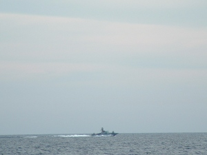 Israeli gunboat flanking the Dignity as it sailed through international waters towards Palestinian waters.