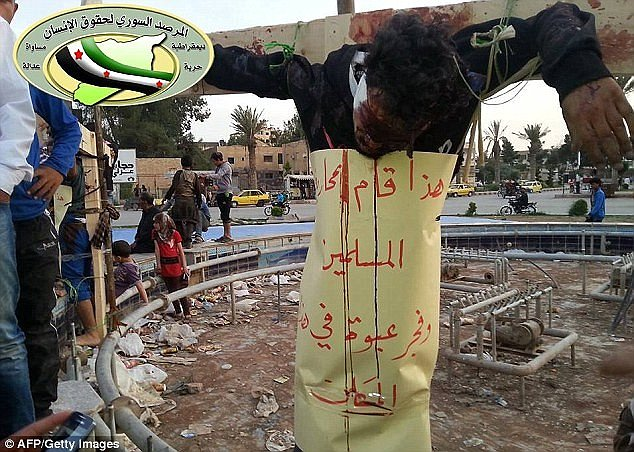 Terrifying: A man believed to have been crucified by fighters from the Islamic State of Iraq and Syria (ISIS) in the northern Syrian city of Raqqa