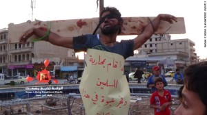 A body is strung up on a cross in the northern Syrian city of Raqqa on Tuesday, April 29. The al Qaeda splinter group ISIS said the brutal display serves as a lesson to anyone who dares challenge its rule. from:  https://www.facebook.com/Raqqa.Slaughtered