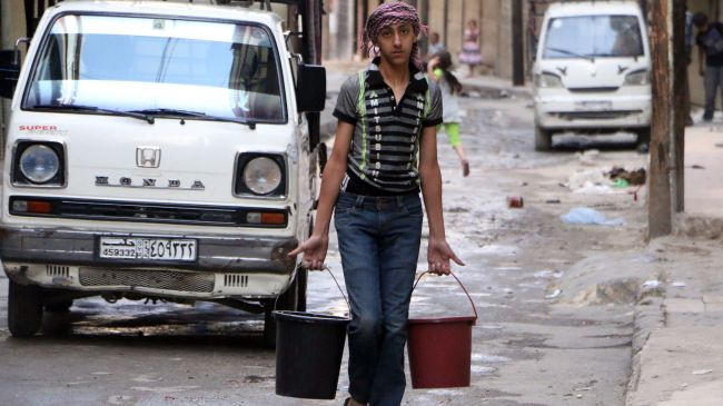 A Syrian boy carries buckets of water in Aleppo on May 10, 2014 after militants cut water supplies into the city.