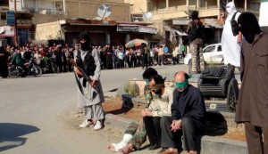 Public execution of three Syrian civilians by extremist militants in Raqqa