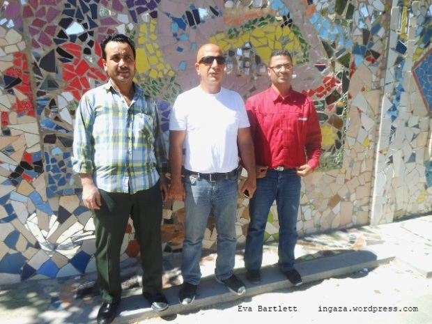 Moaffak Makhoul (centre), co-creater of the now famous wall mural.