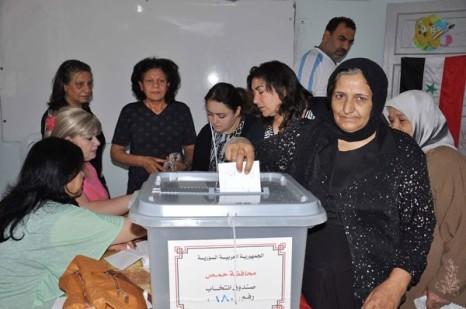 Syrians in Homs vote, Sana News