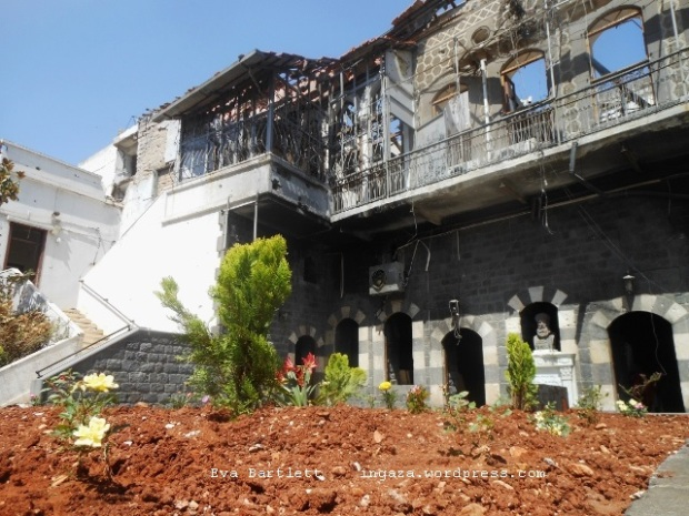 Volunteers have planted a garden in the courtyard of the burned St. Mary's Church in Homs. Credit: Eva Bartlett/IPS