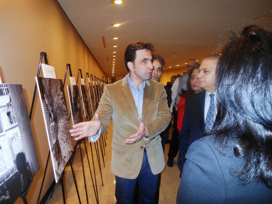 Syrian photographer, Hagop Vanesian, explaining the human stories behind the photos.