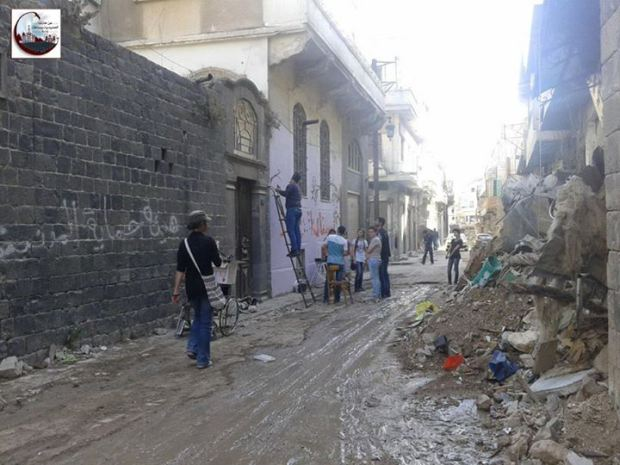 Walking the streets of liberated Homs, June 2014.