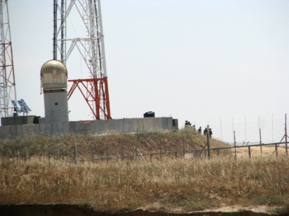 One of many remotely-controled machine-gun towers along fence enclosing Gaza.