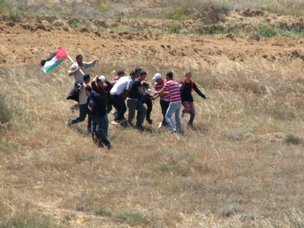 Running from Israeli fire, 2010.