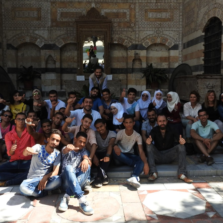 "Volunteers from the Saaed Association relax after the second day of 'Eid activities for children. Instead of clothes or money, ""we gave children hope and joy,"" one volunteer said. In contrast to the sectarianism imposed on Syria by Gulf States and Turkey, Syrians maintain their unity and secularism, emphasized by such volunteers whose allegiance is to humanitarism and helping the less fortunate. See: https://ingaza.wordpress.com/2016/07/27/volunteerism-in-syriaa-journalists-journey-to-the-heart-of-syria/"