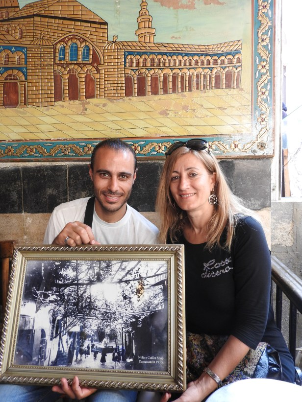 Two Syrian friends in an old cafe, old Damascus. They tell me, he is Alawi, she is Sunni, they are close friends. I hear this everywhere I go in Syria.