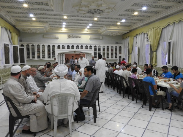 Invited by Mufti Hassoun to iftaar meal in Rowda mosque, Aleppo, July 2016. A female in such a setting would be unthinkable in Saudi Arabia, which supports terrorism in Syria.