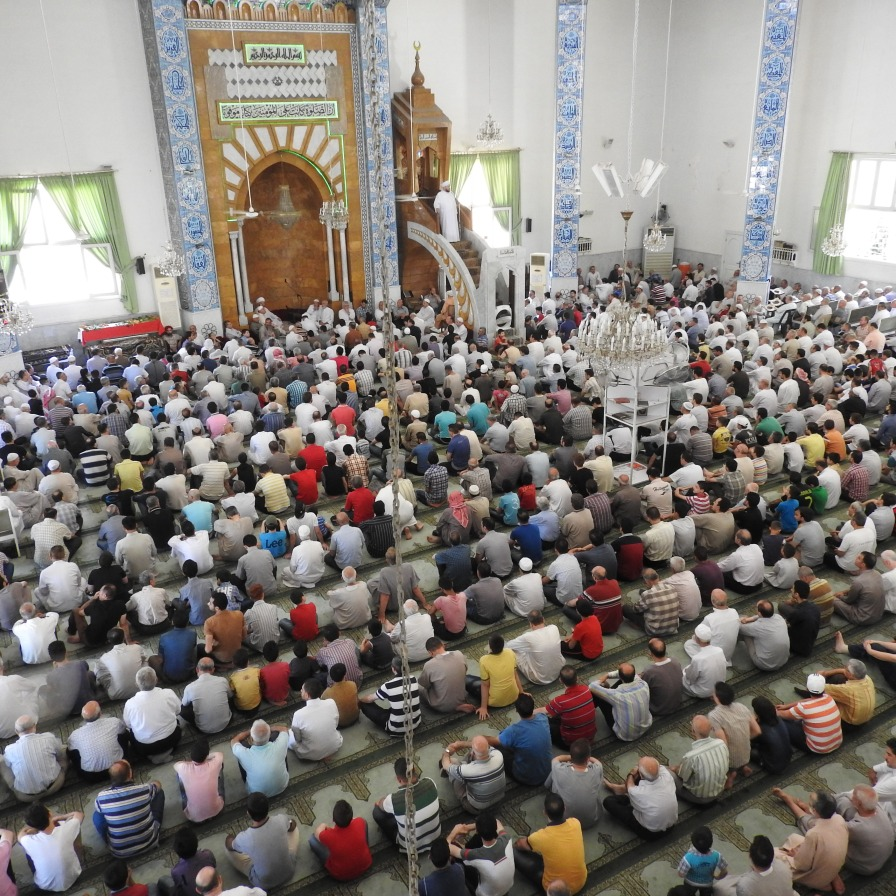 "Ramadan prayers in the Rowda mosque, where Grand Mufti Hassoun used to give sermons. According to his assistant, before the war on Syria about 500 women regularly came to pray at the mosque. ""Six or so months ago, a mortar hit the mosque. It bounced off the dome and fell outside in the courtyard. There were about 400 children here learning the Quran. If it had gone through the roof, it would have killed a lot of children,"" he said. The worshippers at this mosque are predominately Sunni, in a city secured by the Syrian government. This is notable in that it contradicts the Western media's blatant propaganda about a sectarian war, a ""Sunni uprising against the government"". https://ingaza.wordpress.com/2016/09/22/aleppo-and-nearby-villages-ravaged-by-the-wests-moderate-terrorists-photo-essay/"