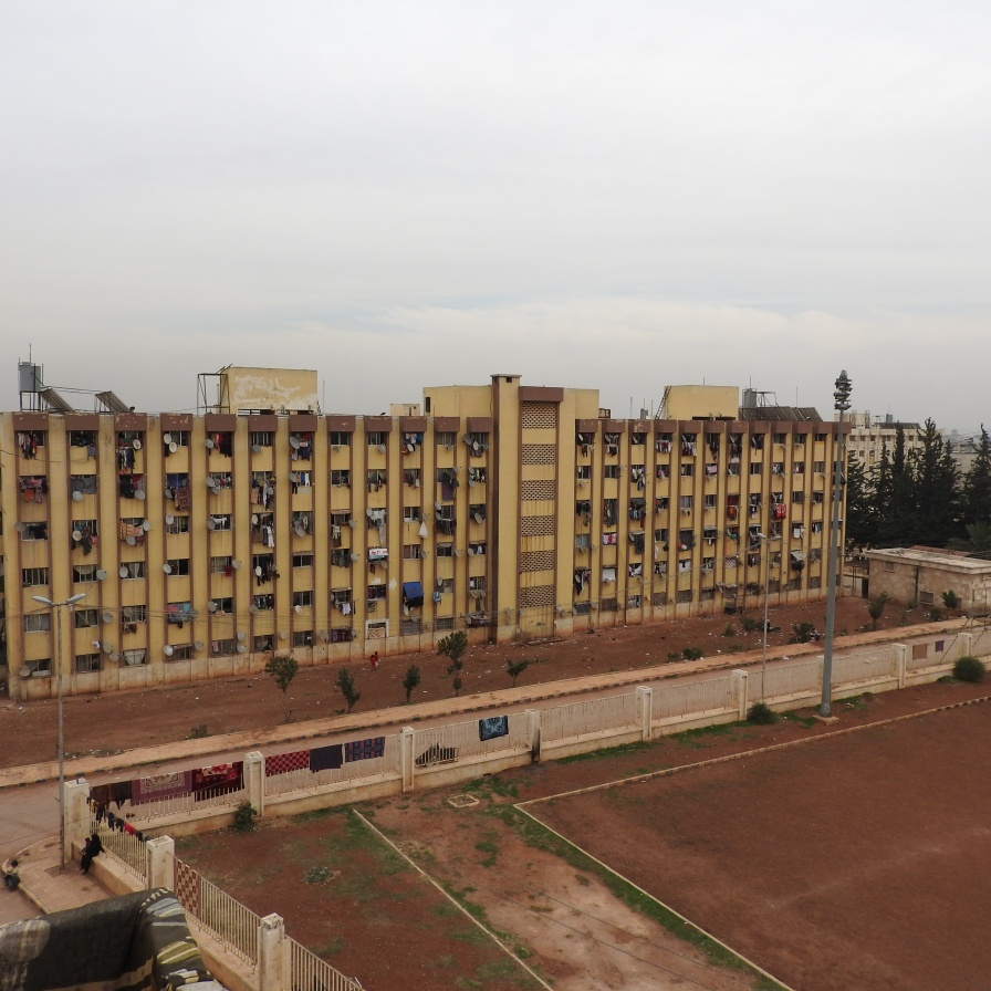 At the time I visited, in November 2016, Aleppo University residences had been housing well over 10,000 internally displaced Syrians from areas of Aleppo and its countryside for around 4 or more years. One of the residences was hit by a terrorist missile the week prior, killing four from one family. While at the Aleppo University residences, a woman stopped me to say hello. She spoke very articulately, about the situation in Aleppo (see: https://www.youtube.com/watch?v=OD2QCZjBSX4). From: https://ingaza.wordpress.com/2016/11/24/overview-of-latest-month-long-visit-to-syria-aleppo-and-damascus/