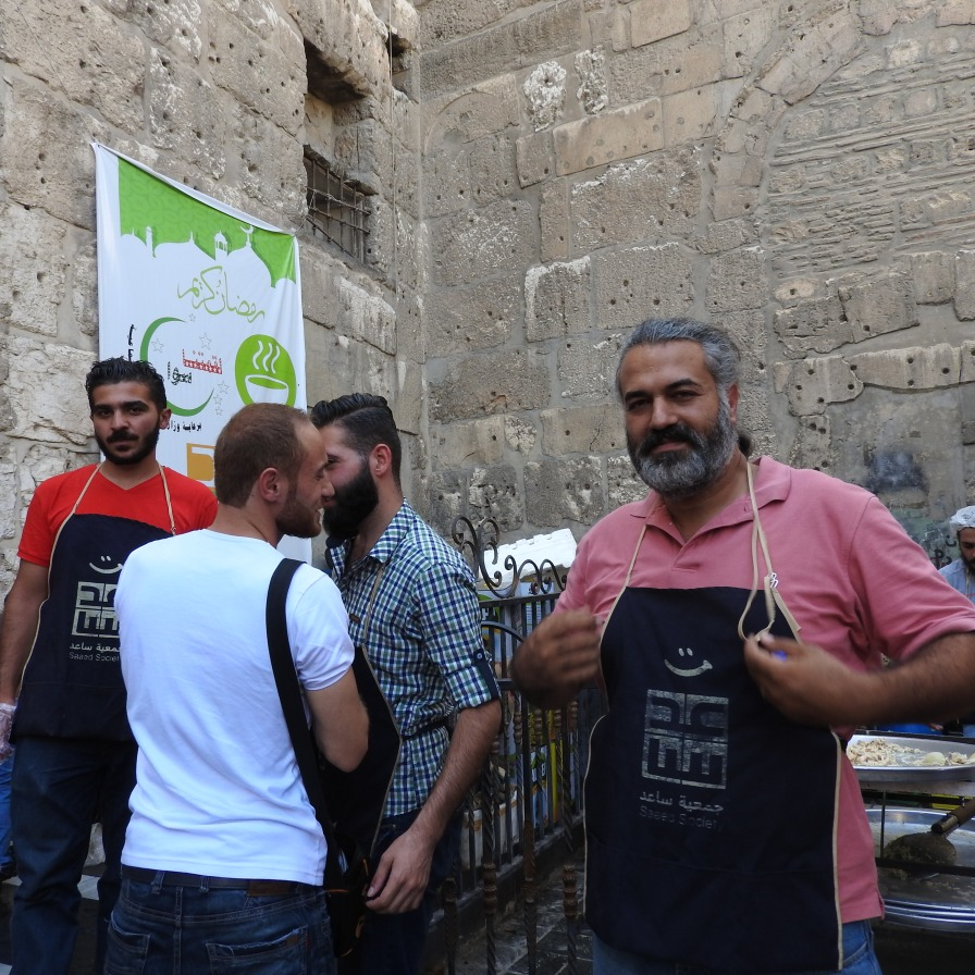 Fadi Assi (a Christian) joins other Saaed volunteers to cook for Damascus' poor during Ramadan.