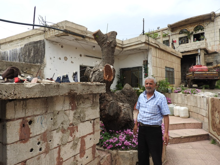 Hadar resident outside of his shrapnel damaged home