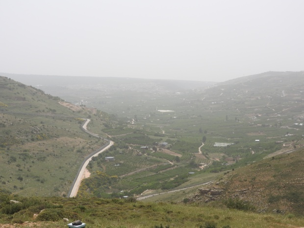 Israeli road cutting through Syrian land at occupied Syrian Golan Heights