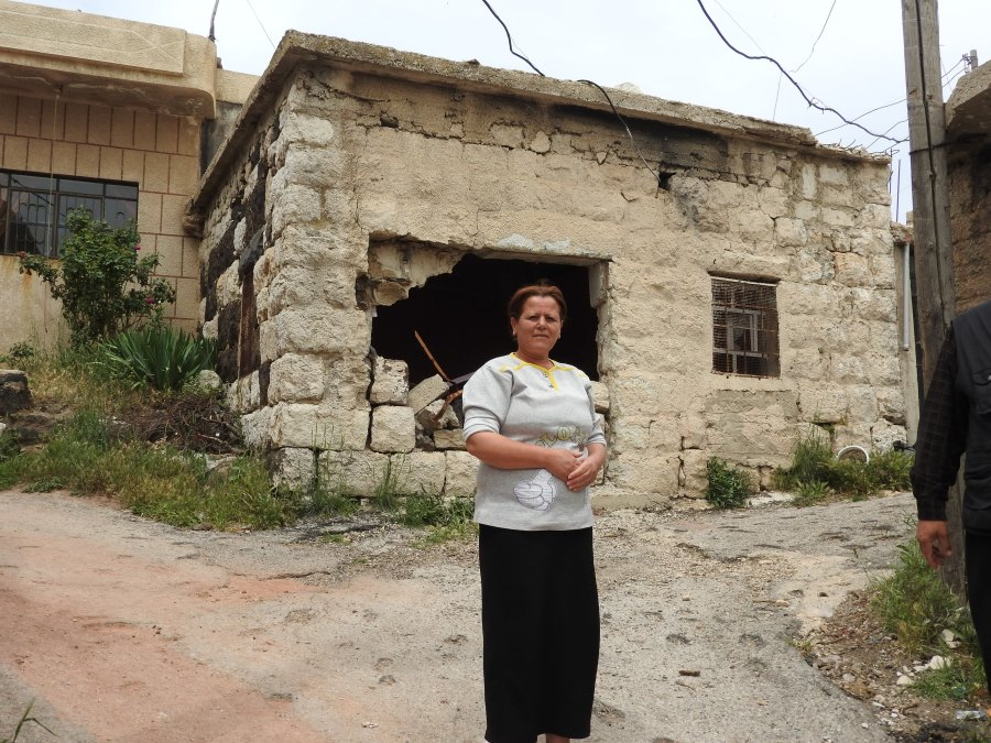 Now unemployed Hadar resident outside her former food and dairy shop destroyed in terrorist shelling in September 2017