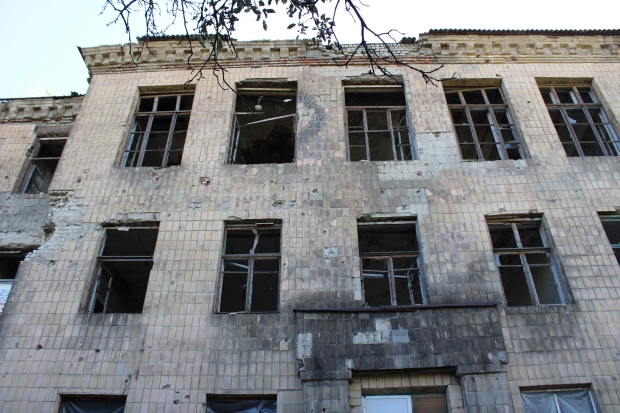 Former school whose basement shelters displaced DPR resident. The school has clearly been attacked by Ukrainian shelling and heavy machine gun fire.JPG