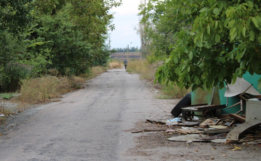 Resident walking towards high risk Ukrainian sniper fire area in order to reach his home